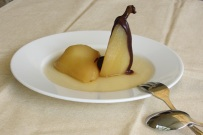 Poached pears topped with chocolate sauce